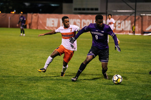 Mo Adams works to track down a Northwestern player Sunday night.